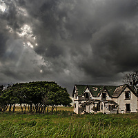 Old house and trees in a storm, Oklahoma.