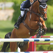 Adrienne Sternlicht riding Quidam MB in action during the $35,000 Grand Prix of North Salem presented by Karina Brez Jewelry during the Old Salem Farm Spring Horse Show, North Salem, New York, USA. 15th May 2015. Photo Tim Clayton