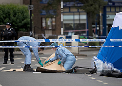 © Licensed to London News Pictures. 08/06/2020. London, UK. Police forensics bag up an electric scooter, at the scene on Askew Road in Shepherd's Bush, west London where a man in his 20's was shot dead in the early hours of this morning. Photo credit: Ben Cawthra/LNP