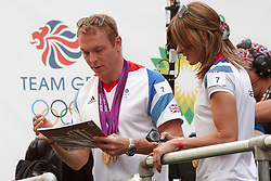 © Licensed to London News Pictures.  10/09/2012. LONDON, UK. Cyclist Sir Chris Hoy (pictured centre) signs autographs  during the Olympic and Paralympic Parade of athletes through central London. Photo credit :  Cliff Hide/LNP