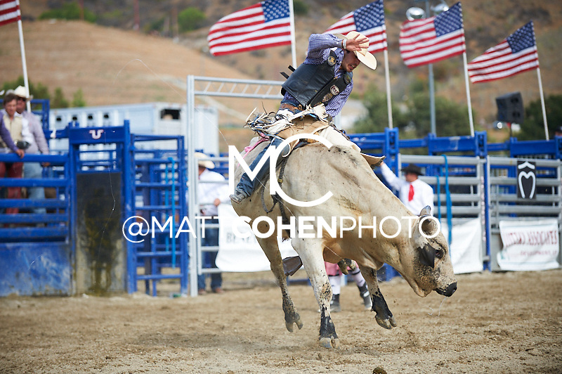Bull rider Tim Bingham of Honeyville, UT rides 6448/1 Frankenstein at the Rancho Mission Viejo Rodeo in San Juan Capistrano, CA.  <br /> <br /> <br /> UNEDITED LOW-RES PREVIEW<br /> <br /> <br /> File shown may be an unedited low resolution version used as a proof only. All prints are 100% guaranteed for quality. Sizes 8x10+ come with a version for personal social media. I am currently not selling downloads for commercial/brand use.