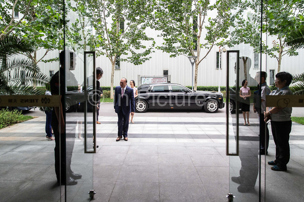 Billionaire Li Jinyuan, chairman of Tiens Group, gets out of his Rolls Royce after arriving at the companys headquarters in Tianjin, China on Tuesday, Aug. 9, 2016. Tiens is a direct sales firm specializing in health and beauty products.