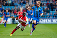 Charlton Athletic forward Igor Vetokele (14) and Gillingham FC defender Connor Ogilvie (34) during the EFL Sky Bet League 1 match between Gillingham and Charlton Athletic at the MEMS Priestfield Stadium, Gillingham, England on 27 April 2019.