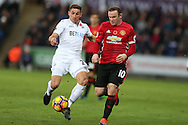 Wayne Rooney of Manchester Utd is challenged by Angel Rangel of Swansea city.  Premier league match, Swansea city v Manchester Utd at the Liberty Stadium in Swansea, South Wales on Sunday 6th November 2016.<br /> pic by  Andrew Orchard, Andrew Orchard sports photography.