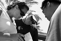 Yvonne Reid, Andrew Baglin, and Ivan Tuen discuss the results of the round robin.  Portimao Portugal Match Cup 2010. World Match Racing Tour. Portimao, Portugal. 26 June 2010. Photo: Gareth Cooke/Subzero Images