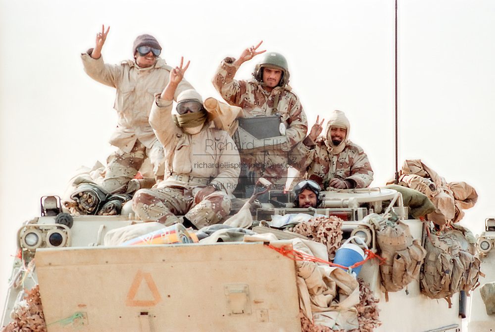 Saudi Arabian soldiers flash the victory sign during clean up operations following the Battle of Khafji February 2, 1991 in Khafji City, Saudi Arabia. The Battle of Khafji was the first major ground engagement of the Gulf War.