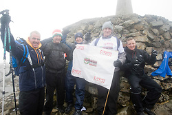 Iain King with John at the top..The John Hartson Foudation walk up Ben Nevis..Pic ©2010 Michael Schofield. All Rights Reserved.