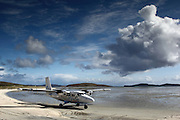 Possibly the only commercial airport in the world where the runway is a beach. This is Barra airport in the Outer Hebrides of Scotland - a small Twin Otter plane lands on the broad sandy beach there approximately twice a day. It is often subject to delays and diversions to nearby Benbecula which has a tarmac runwway. There are no refuelling facilities at Barra, so passenger numbers on the return flight to Glasgow are higher as they have less fuel (13 on the way over, 16 on the return). Quite an exciting flight.