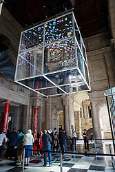 London, UK. 13 September, 2019. Designer Sam Jacob discusses his Sea Things installation within the grand entrance to the V&A museum for the London Design Festival. Designed to highlight the need to rethink the global plastics system, the Landmark Project installation features a large two-way mirrored cube suspended above visitors, with an animated motion graphic within created alongside Rory Cahill. It is intended to evoke powerful emotions in visitors, leaving them empowered with a better understanding of their role alongside technology and design to make the world a more sustainable place.