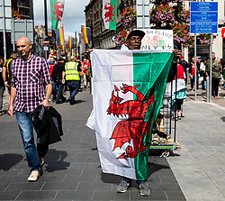 A street vendor selling Wales flags<br /> <br /> Photographer Simon King/Replay Images<br /> <br /> Friendly - Wales v England - Saturday 17th August 2019 - Principality Stadium - Cardiff<br /> <br /> World Copyright © Replay Images . All rights reserved. info@replayimages.co.uk - http://replayimages.co.uk