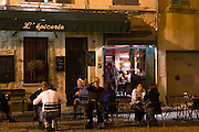 The restaurant l'Epicerie on a town square in Avignon. People having dinner at night. Avignon, Vaucluse, Provence, Alpes Cote d Azur, France, Europe