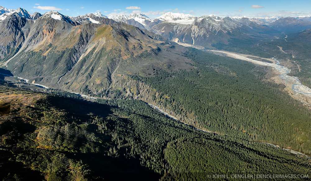 The conflict over putting in a hard-rock mine near the Alaska Chilkat Bald Eagle Preserve near Haines, Alaska took a new turn recently with the filing of a lawsuit by an Alaska Native Tlingit tribe and three environmental groups. The group is suing the Bureau of Land Management, saying that the agency granted mineral exploration permits without considering how a mine could affect the Chilkat River's salmon and the Alaska Chilkat Bald Eagle Preserve. <br /> <br /> Constantine Metal Resources Ltd. of Vancouver, British Columbia along with investment partner Dowa Metals & Mining Co., Ltd. of Japan is exploring a potential site for a mine (located on the upper left side of image) just above Glacier Creek (foreground) and the Klehini River (right side of image). The border with British Columbia is at the upper right. The area above Glacier Greek, known as the Palmer Deposit is located near mile 40 of the Haines Highway.<br /> <br /> The minerals that Constantine's drilling explorations have found are primarily copper and zinc, with significant amounts of gold and silver.<br /> <br /> Support for a large scale mine such as the Constantine project is divided among residents of Haines, a small community in Southeast Alaska 75 miles northwest of Juneau. The community's needed economic boost from jobs, development and other mine support that a large-scale mine brings is tempting to some. To others, anything that might put the salmon spawning and rearing habitat and watershed resources at risk is simply unimaginable and unacceptable. Of particular concern is copper and other heavy metals in mine waste leaching into the Klehini River (shown) and the Chilkat River 14 miles downstream. Copper and heavy metals are toxic to salmon and bald eagles.<br /> <br /> The Chilkat River chum salmon are the primary food source for one of the largest gatherings of bald eagles in the world. Each fall, bald eagles congregate in the Alaska Chilkat Bald Eagle Preserve, located only three miles do