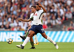 Tottenham Hotspur's Mousa Dembele (right) and Juventus' Paulo Dybala battle for the ball during the pre-season friendly match at Wembley Stadium, London.