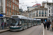 National Express Transit (NET) tram number 202 stopping at a stop in Nottingham, Nottinghamshire, United Kingdom. Trams run throughout the city to stop people using cars and encourage them to use more sustainable transport mechanisms.  (photo by Andrew Aitchison / In pictures via Getty Images)