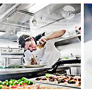 A chef photographed working in his kitchen onboard a ship sailing across the English Channel.