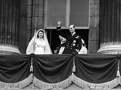 The bride, Princess Elizabeth and groom, the newly created Duke of Edinburgh on the balcony of Buckingham Palace after they were married in a ceremony at Westminster Abbey.