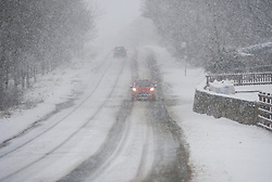 © Licensed to London News Pictures. 13/03/2013..North Yorkshire, England..A car drives towards Staithes as heavy snow falls over North Yorkshire as the wintery weather continues...Photo credit : Ian Forsyth/LNP
