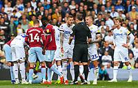 Leeds United's Liam Cooper protests his innocence to referee Stuart Attwell<br /> <br /> Photographer Alex Dodd/CameraSport<br /> <br /> The EFL Sky Bet Championship - Leeds United v Aston Villa - Sunday 28th April 2019 - Elland Road - Leeds<br /> <br /> World Copyright © 2019 CameraSport. All rights reserved. 43 Linden Ave. Countesthorpe. Leicester. England. LE8 5PG - Tel: +44 (0) 116 277 4147 - admin@camerasport.com - www.camerasport.com
