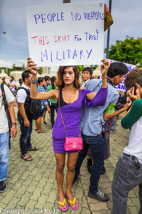 """27 MAY 2014 - BANGKOK, THAILAND: A """"katoey"""" or ladyboy, at Victory Monument in Bangkok protests against the coup. Several hundred people protested against the coup in Bangkok at Victory Monument. It was the fourth straight day of pro-democracy rallies in the Thai capital as the army continued to tighten its grip on Thai life. The protest Tuesday was the smallest so far.     PHOTO BY JACK KURTZ"""