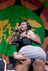 02 May 2015. New Orleans, Louisiana.<br /> The New Orleans Jazz and Heritage Festival. <br /> Big Freddia 'Queen of Bounce' brings some festival goers on stage to show off their bouncing at the Gentilly Stage.<br /> Photo; Charlie Varley/varleypix.com