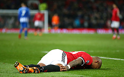 Manchester United's Ashley Young lies on the floor holding his knee
