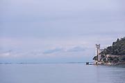 Seascape of Miramare Castle and Adriatic Sea under cloudy sky, Trieste, Italy