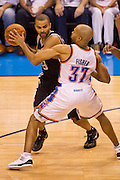 June 2, 2012; Oklahoma City, OK, USA; Oklahoma City Thunder guard Derek Fisher (37) applies pressure as San Antonio Spurs guard Tony Parker (9) looks to make a pass during a playoff game  at Chesapeake Energy Arena.  Thunder defeated the Spurs 109-103 Mandatory Credit: Beth Hall-US PRESSWIRE