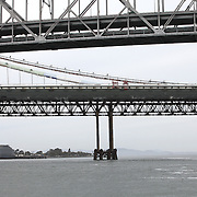 The San Francisco-Oakland Bay Bridge is under construction, and scheduled to open Labor Day 2013. The Self-Anchored Suspension Span (SAS) is the largest bridge of its kind in the world measuring 2,047 feet. This engineering and construction marvel raises the bridge building bar to new heights, as seen in these behind the scenes photos taken on Monday, March 18, 2013. In the foreground with the two levels is the original bridge, with the newly constructed spans in the background. (AP Photo/Alex Menendez)