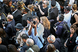 20 November 2015. Orpheum Theater, New Orleans, Louisiana. <br /> Memorial service for musician Allen Toussaint. Photographer Cliff Charles in the street as people  spill out of the Orpheum Theater in a second line procession following the touching memorial service for one of the city's most influential musicians. <br /> Photo; Charlie Varley/varleypix.com
