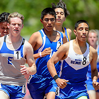 050914       Adron Gardner<br /> <br /> Laguna Acoma Hawk Isaiah Kelsey, center,  paces East Mountain Timberwolf Alex Heffelfinger, left, and Dexter Demon Kyle Bonner, right in the boys 1600m race at  the State Track Meet at the University of New Mexico in Albuquerque Friday. Kelsey would finish second behind Heffelfinger.