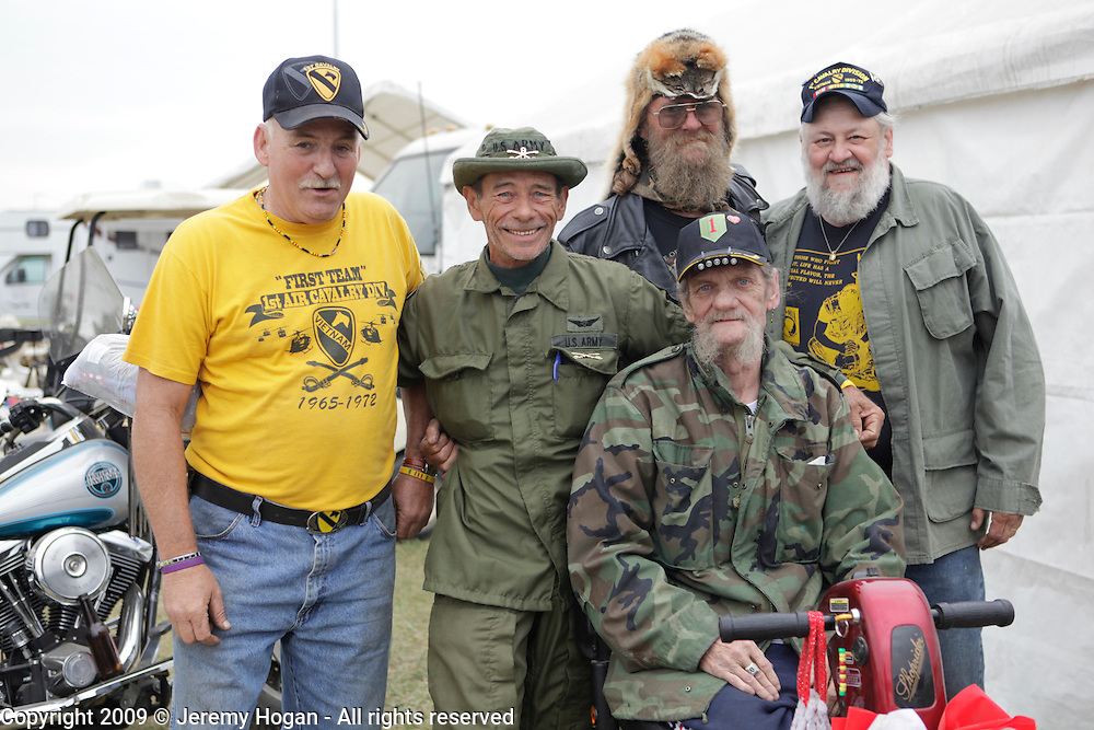 Veterans of the 1st Cavalry, 11th ACR and First Infantry Division pose for a group photo.  Vietnam Veterans gather in Kokomo, Indiana for the 2009 reunion.