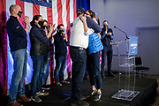 03 NOVEMBER 2020 - DES MOINES, IOWA: THERESA GREENFIELD, the Democratic candidate for the US Senate, hugs her husband, STEVE MILLER, after delivering her concession speech at the Renaissance Des Moines Savery Hotel after her loss in the race for the US Senate. Greenfield conceded to incumbent Republican Sen. Joni Ernst at about 11:45PM November 3.     PHOTO BY JACK KURTZ