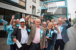 © Licensed to London News Pictures. 20/07/2019. Builth Wells, Powys, Wales, UK. Brexit Party supporters are in high spirits in Builth Wells. The Brexit Party, with  Brecon & Radnorshire constituency candidate Des Parkinson,  bring their campaign to the small Welsh market town of Builth Wells in Powys, UK. in a bid to win a seat in the forthcoming Brecon & Radnorshire constituency by-election on the 1st August 2019. The Brexit Party was founded by former UKIP economics spokeswoman, Catherine Blaiklock in January 2019, and is led by Nigel Farage. The Brexit party has 29 Members of the European Parliament (MEPs) and four Welsh Assembly Members. The party's first major electoral success was winning the 2019 European Parliament election in the United Kingdom after four months in existence. Photo credit: Graham M. Lawrence/LNP