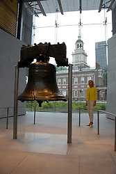 Liberty Bell and Independence Hall, with woman, mod rel..Philadelphia, Pennsylvania, PA USA.  Photo copyright Lee Foster, 510-549-2202, lee@fostertravel.com, www.fostertravel.com. Photo 265-30788