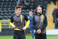 Burton Albion midfielder Marcus Harness (16) and Burton Albion midfielder Ben Fox (12) warm up during the EFL Sky Bet League 1 match between Burton Albion and Wycombe Wanderers at the Pirelli Stadium, Burton upon Trent, England on 26 December 2018.