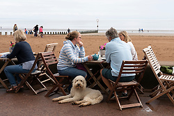 People in cafe beside the beach at Portobello in Edinburgh, Scotland, UK