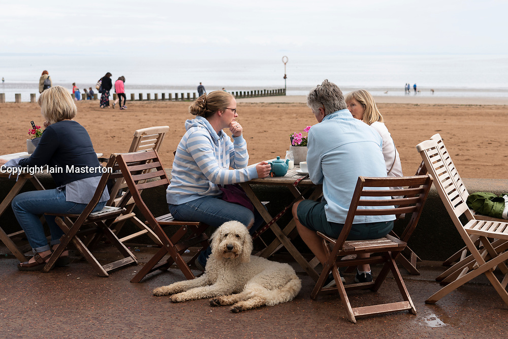 People in cafe beside the beach at Portobello in Edinburgh, Scotland, UK