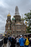 St. Petersburg, Russia -- July 20, 2019. Tourists throng toward the Ornate Church of the Spilled Blood.