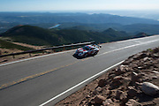 June 26-30 - Pikes Peak Colorado. Jeff Zwart runs his car during practice for the 91st running of the Pikes Peak Hill Climb.