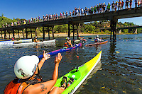 """Members of the Sacramento paddling community, family, and fans of the late Eppie Johnson, gather at the Sunrise Blvd. foot bridge for Memorial Paddle, Sunday, July 13, 2014. Former restaurateur and Eppie's Great Race Founder Eppie Johnson (who passed away in September 2013), was an enthusiastic paddling advocate, leader in the paddling community, and frequent spokesperson promoting the beauty of the American River Parkway, for over 40 years. Eppie launched """"Eppie's Great Race"""" (EGR) 41 years ago, as a triathlon featuring running, biking, and paddling. Since its inception 41 years ago, EGR has grown into the largest single-day, annual kayaking event in the world. And through Eppie's Great Race, Eppie raised and donated over $1.4 Million to support recreation programs for Sacramento County's disabled.<br /> Photo Brian Baer"""