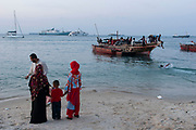 Locals gather at sunset to exercise, play in the water or just gaze out to sea in the islands main settlement Stone Town on 5th December 2008 in Zanzibar, Tanzania. Zanzibar is a small island just off the coast of the Tanzanian mainland in the Indian Ocean. In part due to its name, Zanzibar is a travel destination of mystical reputation, known for its incredible sealife on its many reefs, the powder white coral sand beaches and the traditional cultivation of spices.