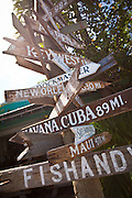 Crossroads sign post showing distance to various cities at the harbor at Stock Island, Key West, Florida.
