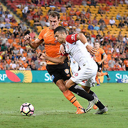 BRISBANE, AUSTRALIA - JANUARY 28: Jaushua Sotirio of the Wanderers and Luke DeVere of the Roar compete for the ball during the round 17 Hyundai A-League match between the Brisbane Roar and Western Sydney Wanderers at Suncorp Stadium on January 28, 2017 in Brisbane, Australia. (Photo by Patrick Kearney/Brisbane Roar)