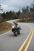 Bill Dragoo rides isolated Highway 16 in central Arkansas.