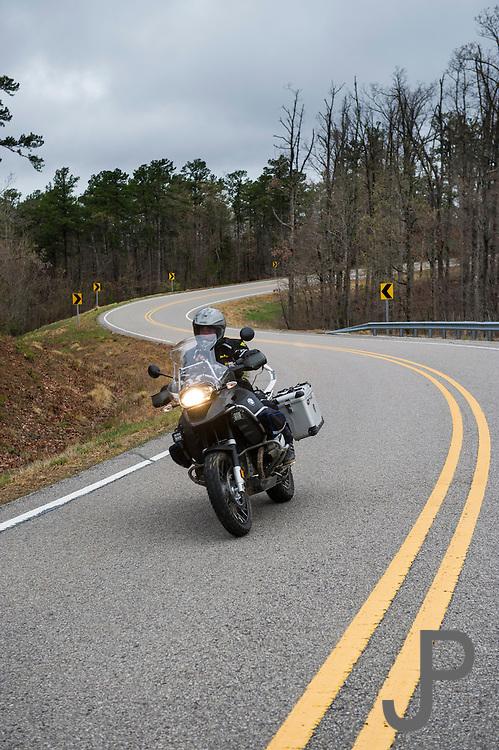 Bill Dragoo rides isolated Highway 16 in central Arkansas.