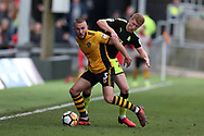Dan Butler of Newport County is challenged by Brad Halliday of Cambridge Utd (r). The Emirates FA Cup, 2nd round match, Newport County v Cambridge United at Rodney Parade in Newport, South Wales on Sunday 3rd December 2017.<br /> pic by Andrew Orchard,  Andrew Orchard sports photography.