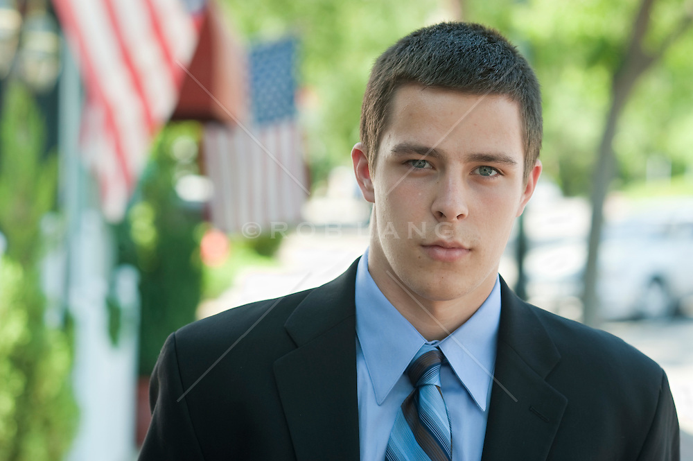 Young blue eyed man in a blue business suit shirt and tie