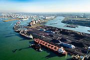 Nederland, Zuid-Holland, Rotterdam, 18-02-2015; Europoort met Calandkanaal in de voorgrond. Ertsoverslagbedrijf Europoort met bulkcarries aan de zeekade die worden gelost door grijperkranen. In de Dintelhaven duwbakken en de kolenterminal. <br /> Europoort with terminals for dry bulk handling, ore and coal for German Steelmaking industry.<br /> luchtfoto (toeslag op standard tarieven);<br /> aerial photo (additional fee required);<br /> copyright foto/photo Siebe Swart
