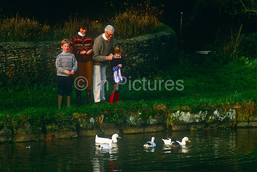 Douglas Hurd MP feeds ducks with his family near the family home in the summer of 1990 near Oxford. Douglas Richard Hurd, Baron Hurd of Westwell, CH, CBE, PC b1930 is a British Conservative politician who served in the governments of Margaret Thatcher and John Major from 1979 to 1995.