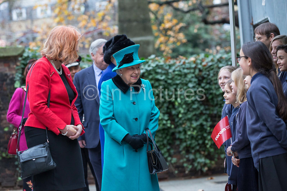 Queen Elizabeth II meets Dr Carol Homden CBE Group Chief Executive of Coram during a visit to childrens charity Coram to open the Queen Elizabeth II centre on 5th December 2018 in London, England. Coram is the UK's oldest childrens charity and was founded by Thomas Coram.